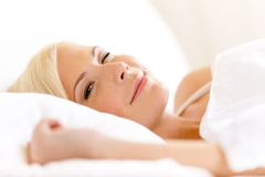 Close up of lying in bed woman Stock Photo