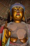 Golden Sakyamuni. Close up of an 11m high statue of a golden Sakyamuni Buddha Stock Images