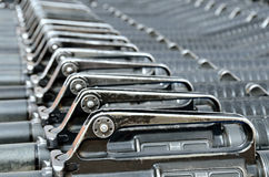 Military background. Close-up of M16 rifles stacked in series Stock Photography