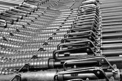 Military background. Close-up of M16 rifles stacked in series. B&W Stock Image