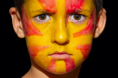 A close up of Macedonian flag. A close up of an Macedonian flag on a boy face over dark background Stock Image