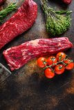 Close up machete Steak, Flank steak, cut near denver alternative beef steak a rustic metall background top view layflat