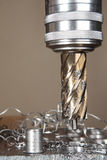 Close-up machining tool drill during metal cutting process borin Royalty Free Stock Photo
