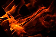 Close up, macro. Abstrack background. Diagonal orange flame in the fireplace. Copy space