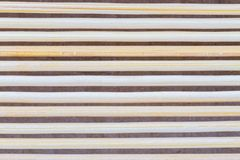 Close up macro of beige brown bamboo mat as striped background t Royalty Free Stock Photo