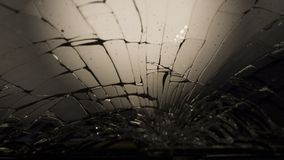 Close-up macro of broken dark glass. Elements of smartphone, screen, hammer blow, dropped smartphone. Close-up macro of broken dark glass. Abstract black royalty free stock photos