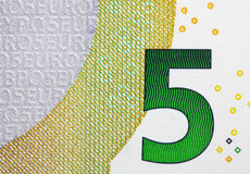 Close up macro detail of fifth euro money banknote.. Stock Images
