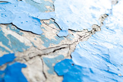 Close-up Macro of flaking blue paint on a white concrete background. The pain Stock Photography