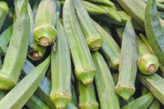 Close up macro of fresh green okra for sale on open street city. Market in Stuttgart, Germany Royalty Free Stock Photography