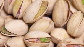 Close up. macro. Fried pistachios in a shell rotate in a circle. background.  stock video footage