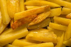 Close up, macro. Fried potatoes. Slices of chopped potatoes are fried in vegetable oil stock images