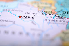 Close-up macro image of map France. Selective focus on Paris Stock Images