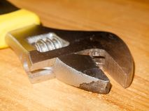 Close up macro of mechanical metal spanner tool on table Stock Photo