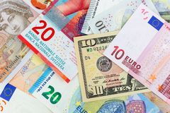Close-up macro photography of dollar, pound, euro and frank. Business money exchange concept background. Close-up macro photography of dollar, pound, euro and royalty free stock image