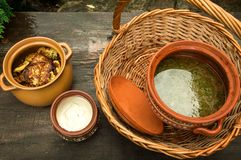 Close up, macro. National Ukrainian lunch in the home garden. Food is served in traditional pottery, wicker basket royalty free stock images
