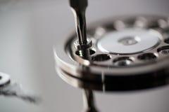Close up macro on screwdriver unscrewing torx screw Stock Images
