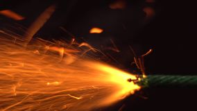 Close up macro shot of Burning fuse firecracker. Setting fire to wick of bomb stock video footage
