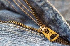 Close up macro shot details of denim blue jeans zipper, selective focus, jeans fashion background concept stock image