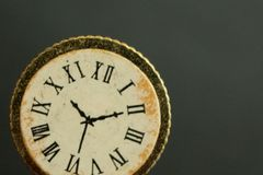 A macro-shot of a vintage clock or watch showing the time. royalty free stock images