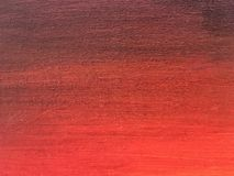 Close-up paint on canvas. Close-up macro shot of red paint on canvas. Fragment of gradient picture on wall Royalty Free Stock Image