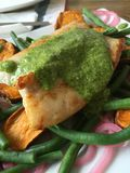 Close up macro shot of seafood dish - fish with pesto sauce and vegetables Royalty Free Stock Photo