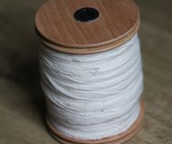 Spun sheep`s wool on wooden background. Close up macro spun sheep`s wool placed on wooden ground Royalty Free Stock Photos