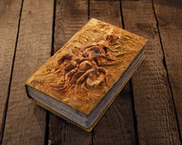 Close up of magic book with golden cover and marine monster image royalty free stock photo