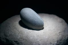 Close up of Magic healing stone for spa treatments. Isolated on black background Royalty Free Stock Image