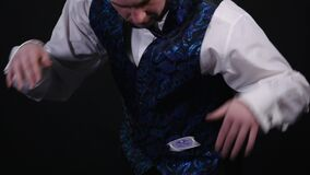 Close-up of a Magician`s Hands Performing Card Trick in the Air. Background is Black.  stock footage