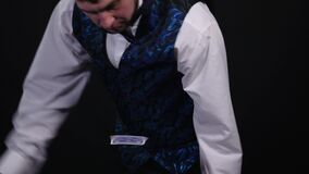 Close-up of a Magician`s Hands Performing Card Trick in the Air. Background is Black.  stock video