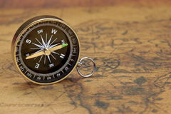 Close Up Of Magnetic Compass On The Old Map Royalty Free Stock Photos