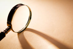 Close up Magnifying Glass on Brown Platform Royalty Free Stock Image