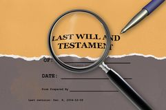 Close up of magnifying glass of Last Will and Testament Stock Image