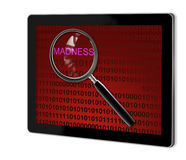Close up of magnifying glass on madness Stock Photo