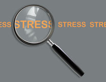 Close up of magnifying glass on stress Stock Photo