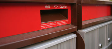 Close up of a mail drop chute on a mailbox Stock Images