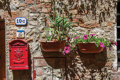 Close-up of mailbox of the post office and flower pots in Colle di Val d`Elsa. A graceful village with its historic center preserved and known by its crystal Stock Images