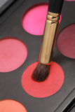 Close-up make-up brush. Cosmetic brushes and makeup colors Stock Photo