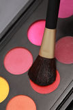 Close-up make-up brush. Cosmetic brushes and makeup colors Royalty Free Stock Images