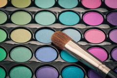 Close-up of make-up brush on colorful palette Stock Image