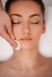 Close-up of make up removal. Stock Images