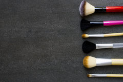 Close up of makeup brushes on black background. Top view Royalty Free Stock Photography