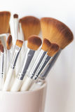 Close up of makeup brushes. In a pink cup Royalty Free Stock Images