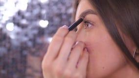 Close up. Makeup The girl makes an eyebrow shape. 4K Slow Mo. Close up. Makeup The girl makes an eyebrow shape stock video footage