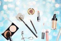 Close up of makeup stuff over blue lights Stock Image