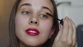 Close up of makeup vlogger influencer creating cosmetic product explainer video. Young woman is filming a new episode
