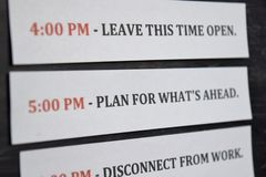 Close up making agenda Daily schedule on personal organizer. Business and entrepreneur concept. Isolated on black background royalty free stock photo