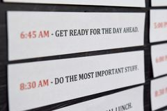 Close up making agenda Daily schedule on personal organizer. Business and entrepreneur concept. Isolated on black background royalty free stock image