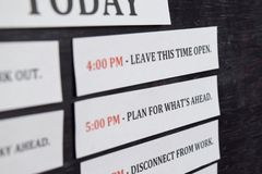 Close up making agenda Daily schedule on personal organizer. Business and entrepreneur concept. Isolated on black background stock image