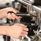 Close up making coffee cappuccino with machine Royalty Free Stock Images